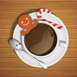 Gingerbread in cup of hot chocolate with sugar cane Royalty Free Stock Photography