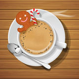 Gingerbread in cup of hot coffeee with sugar cane Royalty Free Stock Photo