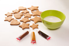 Gingerbread decoration. On the white background with green bowl Stock Images
