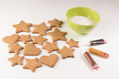 Gingerbread decoration. On the white background with green bowl Royalty Free Stock Photography
