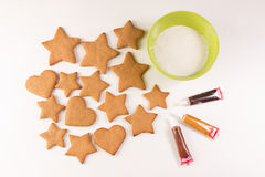 Gingerbread decoration. On the white background with green bowl Royalty Free Stock Images