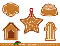 Gingerbread Dog Treats. Good dogs get Christmas holiday gingerbread cookies with icing: star ornament with ribbon, doghouse, dog face, fire hydrant, dog dish Royalty Free Stock Images