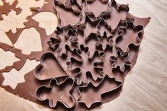 Gingerbread dough and Christmas cookie cutters Stock Photo