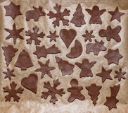 Gingerbread dough and Christmas cookie cutters Stock Photos