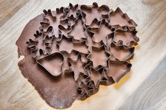 Gingerbread dough and Christmas cookie cutters Royalty Free Stock Photography