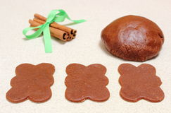 Gingerbread dough for Christmas cookies and cinnamon sticks Royalty Free Stock Images