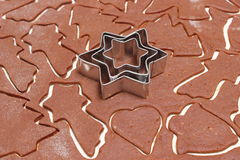 Gingerbread dough for Christmas cookies and cookie cutters Royalty Free Stock Image