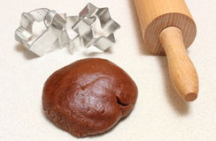 Gingerbread dough for Christmas cookies, cookie cutters and rolling pin Royalty Free Stock Photos
