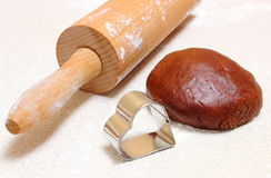 Gingerbread dough for Christmas cookies, cookie cutters and rolling pin Stock Image