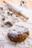 Gingerbread dough for christmas. Gingerbread dough for gingerbread men and forms for cookies Stock Photos