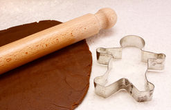 Gingerbread dough, rolling pin and cookie cutter Stock Image