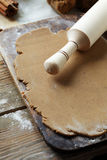 Gingerbread dough and rolling pin Stock Image