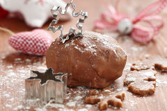 Gingerbread dough and snowflake cutter Royalty Free Stock Photos