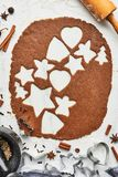 Gingerbread dough with various shape cookie cutout stock photo