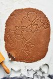 Gingerbread dough with various shape cookie cutout royalty free stock images