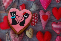 Gingerbread with drawings of the beast with hearts for the feast of the holy valentine. Gingerbread with animals, with hearts on holiday, valentine Stock Photos