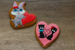 Gingerbread with drawings of the beast with hearts for the feast of the holy valentine. Two gingerbread with animals, with hearts on holiday, valentine Stock Photography