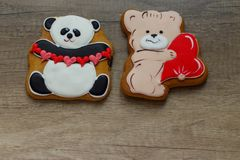 Gingerbread with drawings of the beast with hearts for the feast of the holy valentine. Two gingerbread with animals, with hearts on holiday, valentine Royalty Free Stock Photos