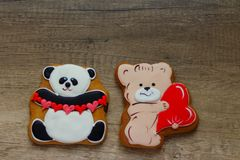 Gingerbread with drawings of the beast with hearts for the feast of the holy valentine. Two gingerbread with animals, with hearts on holiday, valentine Stock Photo