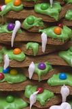 Gingerbread with Dripping Icing. Gingerbread cookie with green icing and Christmas decorations close up Royalty Free Stock Photo