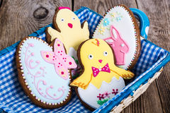 Gingerbread with Easter theme on a wooden background Stock Photos