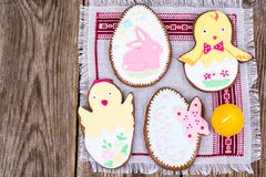 Gingerbread with Easter theme on a wooden background Royalty Free Stock Images