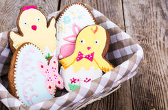 Gingerbread with Easter theme on a wooden background Royalty Free Stock Photography