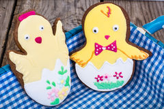Gingerbread with Easter theme on a wooden background Royalty Free Stock Photo