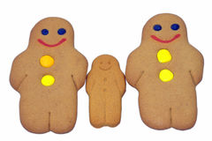 Gingerbread family. Three ginger bread biscuits is a row Royalty Free Stock Images