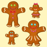 Gingerbread family. Set of four gingerbread stylized people � parents and children Royalty Free Stock Image