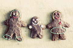 Gingerbread family. Handmade in home. Vintage Royalty Free Stock Photo