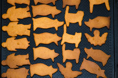 Gingerbread figures on a baking sheet Royalty Free Stock Photo