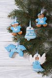 Gingerbread figures on the Christmas tree Royalty Free Stock Photo