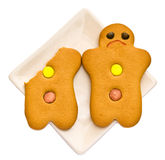 Gingerbread friendship. Gingerbread on white background, imitation of human emotions Stock Images