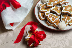 Gingerbread gifts wrapped in red ribbon Stock Photo