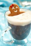 Gingerbread girl in hot chocolate Stock Photos