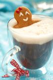 Gingerbread girl in hot chocolate Stock Images