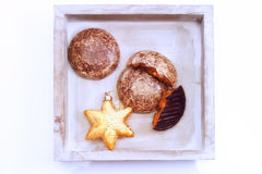 Gingerbread and golden bauble in wood bowl Royalty Free Stock Image