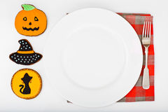 Gingerbread for Halloween with Empty White Plate and Place for Y stock photo