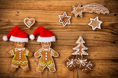 Gingerbread happy creatures on wood Royalty Free Stock Images