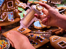 Gingerbread hause making by child hands. Royalty Free Stock Image