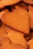 Gingerbread heart. With various other gingerbread shapes in background Stock Images