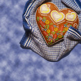 Gingerbread heart on blue background Stock Image