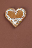 Gingerbread heart on brown Royalty Free Stock Photos
