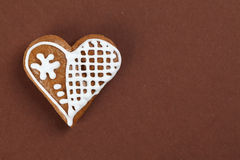 Gingerbread heart on brown Stock Photo
