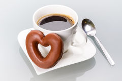 Gingerbread heart with coffee cup. Gingerbread heart with coffee as a love symbol Stock Photo
