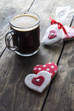 Gingerbread heart and coffee  on rustic wooden background Stock Photo