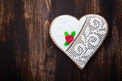 Gingerbread heart cookie on wooden background royalty free stock images