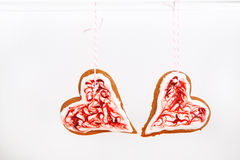 Gingerbread heart cookies hanging on white background. Royalty Free Stock Images