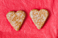 Gingerbread heart cookies on red background Stock Photos